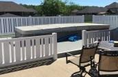 vinyl fencing surrounding outdoor above ground pool