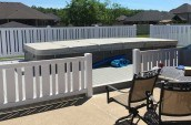 vinyl fencing surrounding outdoor above ground pool