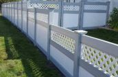 cypress pvc vinyl fence with decorative elements attached to home