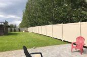 backyard patio with chairs surrounded by pvc vinyl privacy fence