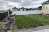 pvc vinyl privacy fence lining far side of home backyard