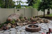 jasper pvc vinyl privacy fence surrounding backyard with stone walkway and garden