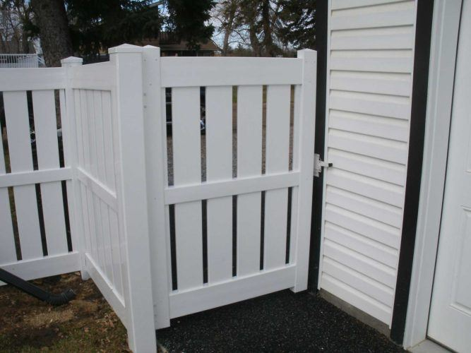 semi-privacy vinyl fence door attached to home