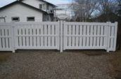 semi-privacy vinyl fence gate in front of home